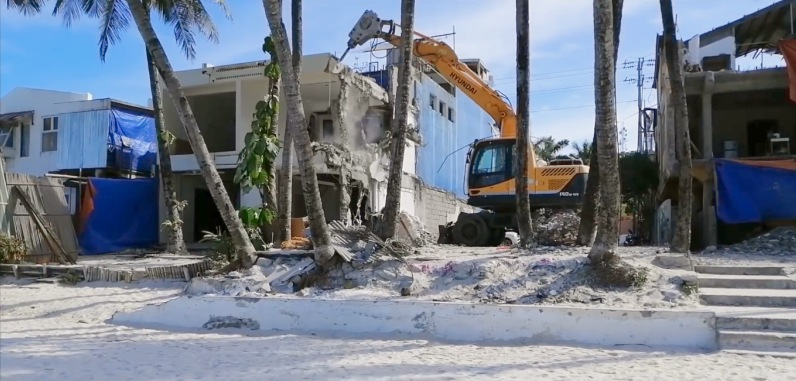 Demolition of buildings along the beach front of White Beach, Boracay